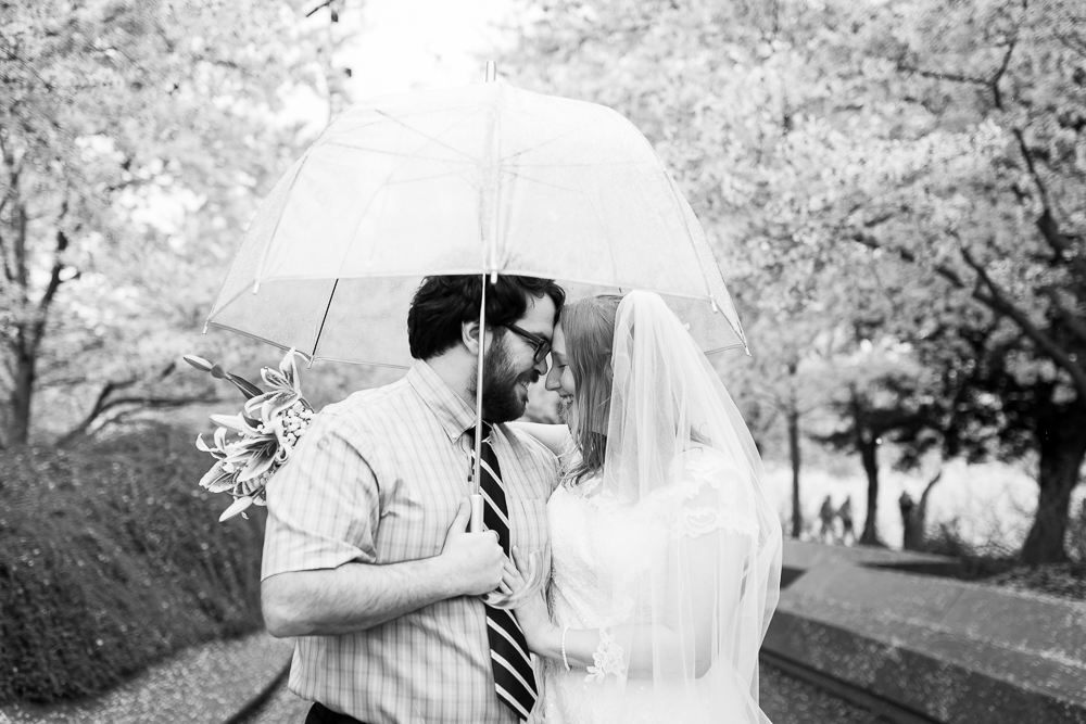 Black and white wedding photo of bride and groom at the Tidal Basin