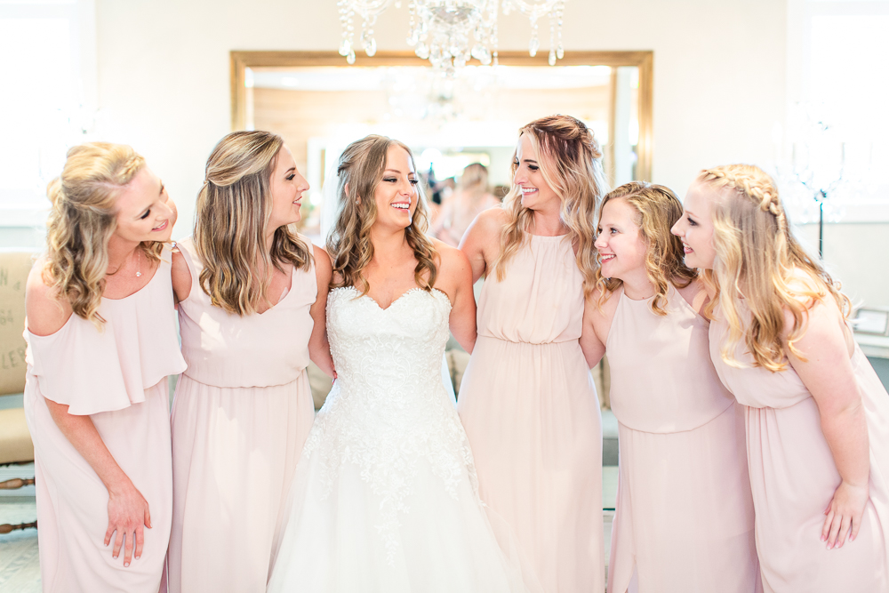 Bride with her bridesmaids in the bridal suite at the Mount Ida Lodge
