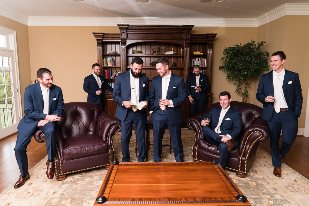 Editorial photo of groom with groomsmen in The Aventador house at Mount Ida Farm