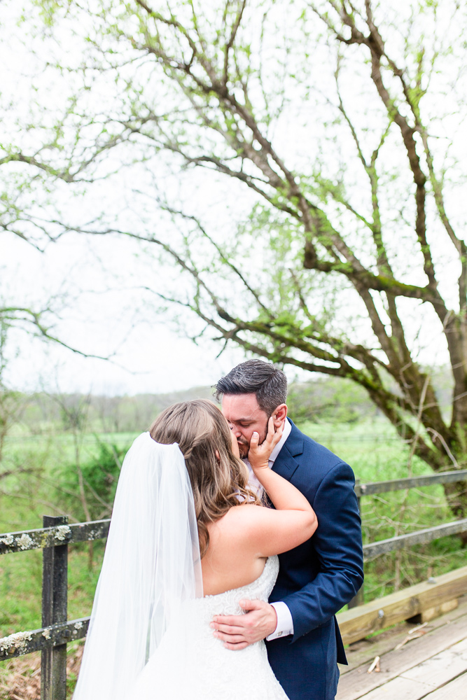 Bride and groom kiss after their first look on their wedding day