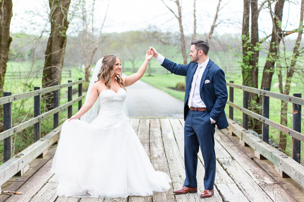 Husband and wife dancing on the wooden bridge at Mount Ida Farm | Charlottesville, Virginia wedding venue