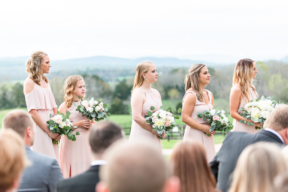 Bridesmaids during wedding ceremony, with views of the Blue Ridge Mountains behind them