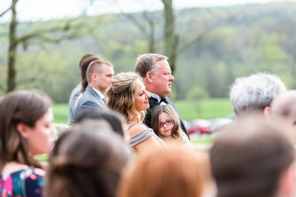 Bride's parents watching the wedding ceremony