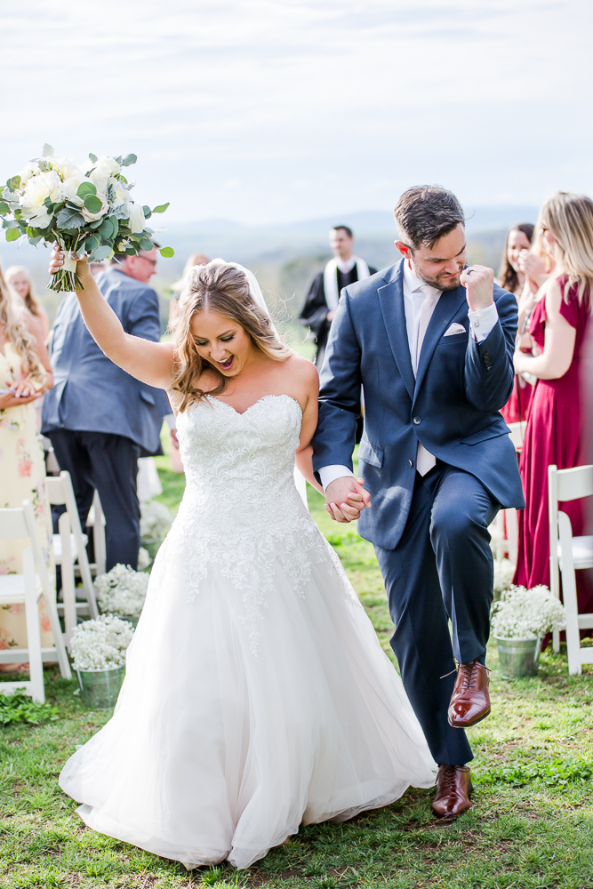Fun and candid moment as bride and groom finish their wedding ceremony   Candid Charlottesville wedding photographer