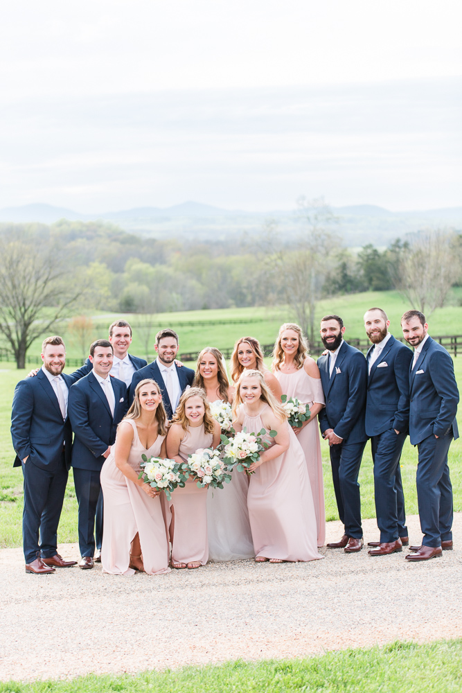 Navy and blush bridal party in front of the mountain views at the Lodge at Mount Ida Farm