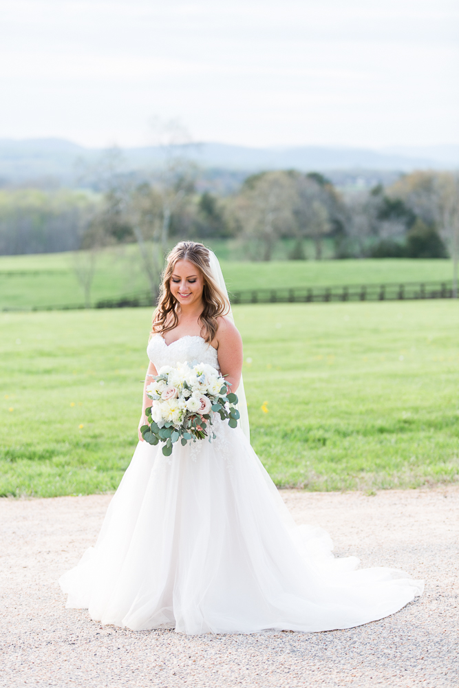 Beautiful bride with her bouquet at Mount Ida Farm in the Blue Ridge Mountains