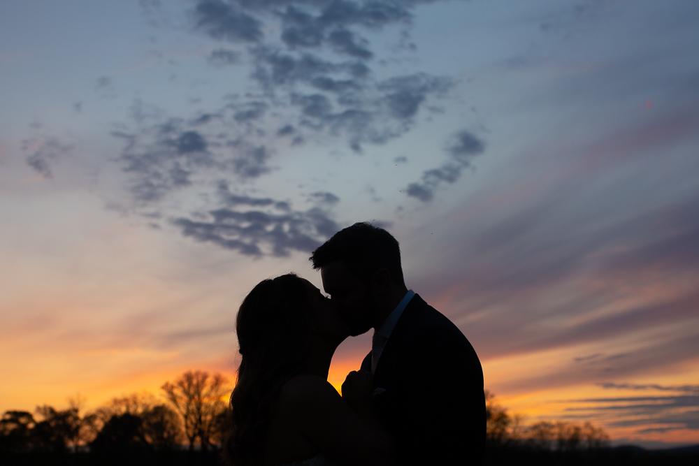 Sunset silhouette wedding photo