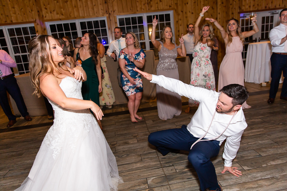 Husband and wife having fun at their wedding reception   Candid Charlottesville wedding photographer