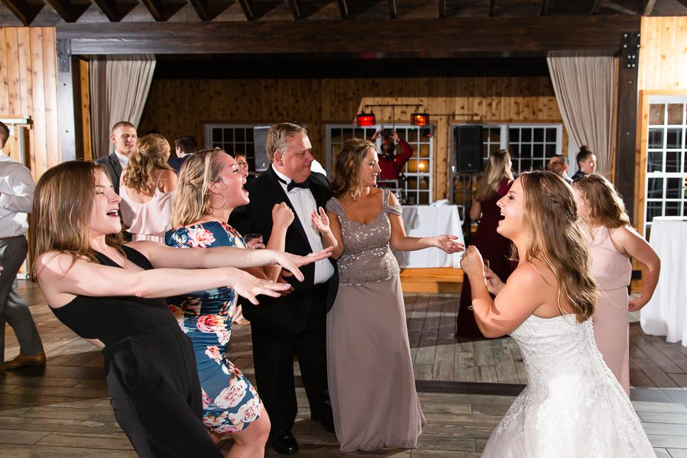 Candid dancing photos during wedding reception at the Lodge at Mount Ida Farm