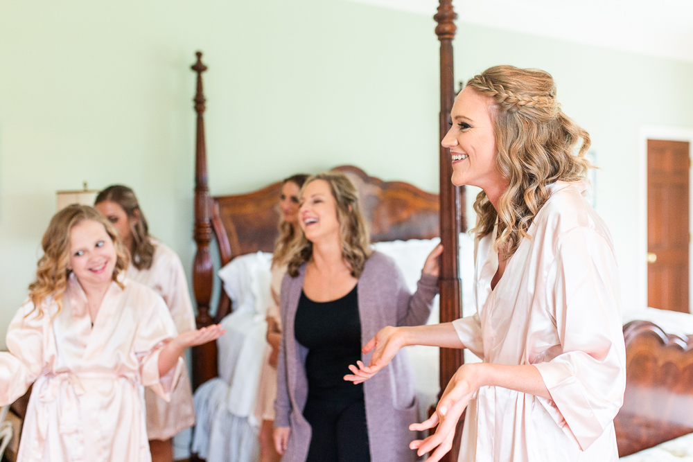 Bridesmaids laughing and hanging out in the bridal suite at The Aventador at Mount Ida Farm