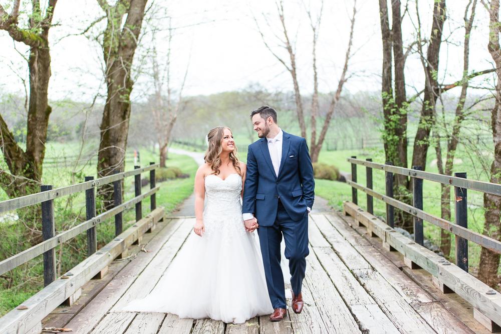 Smiling wedding couple on the bridge at Mount Ida Farm in Charlottesville