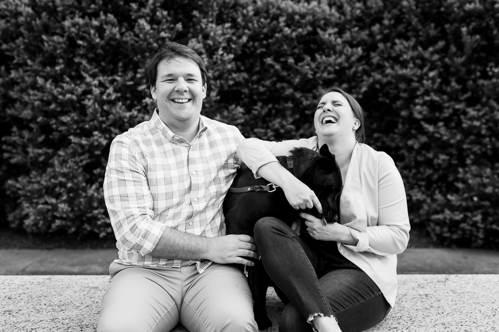Candid engagement photographer in Washington, DC | engaged couple laughing with their dog