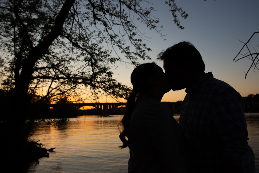 Sunset engagement photo over the river at Roosevelt Island in Washington, DC