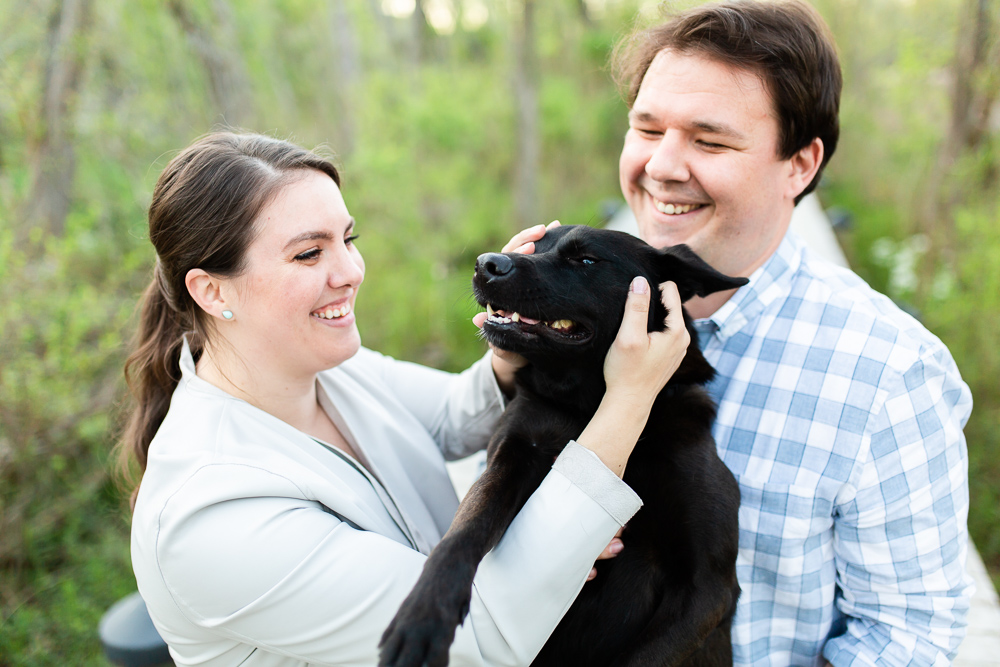 Candid engagement photo of couple laughing with their dog | Candid Washington, DC engagement photographer
