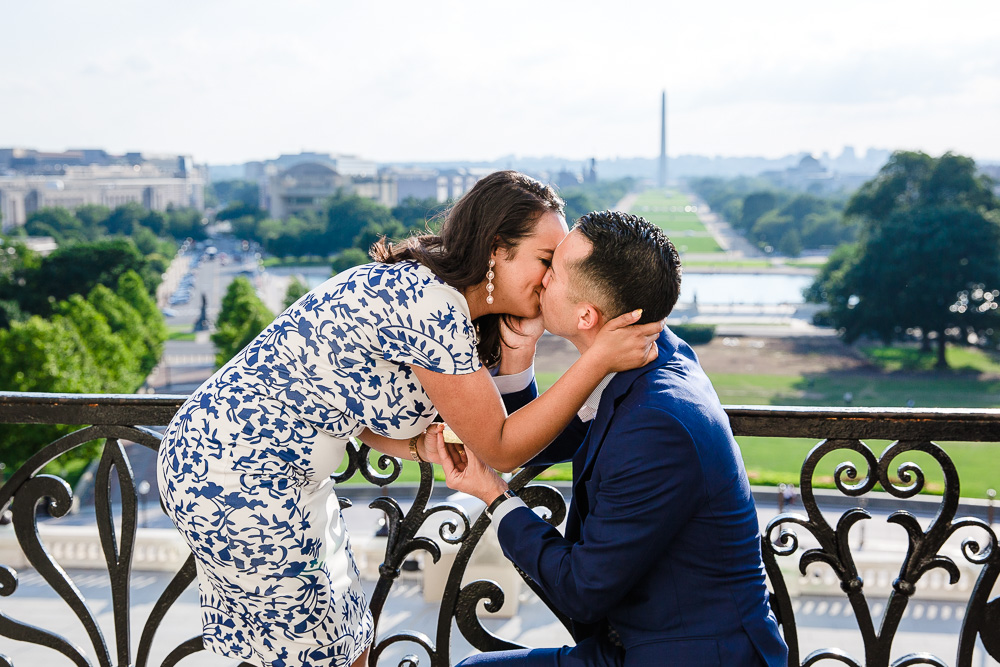 Newly engaged couple kisses on the Speaker's Balcony of the U.S. Capitol Building | DC engagement photographer