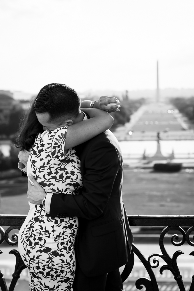 Black and white engagement photo with National Mall and Washington Monument in the background