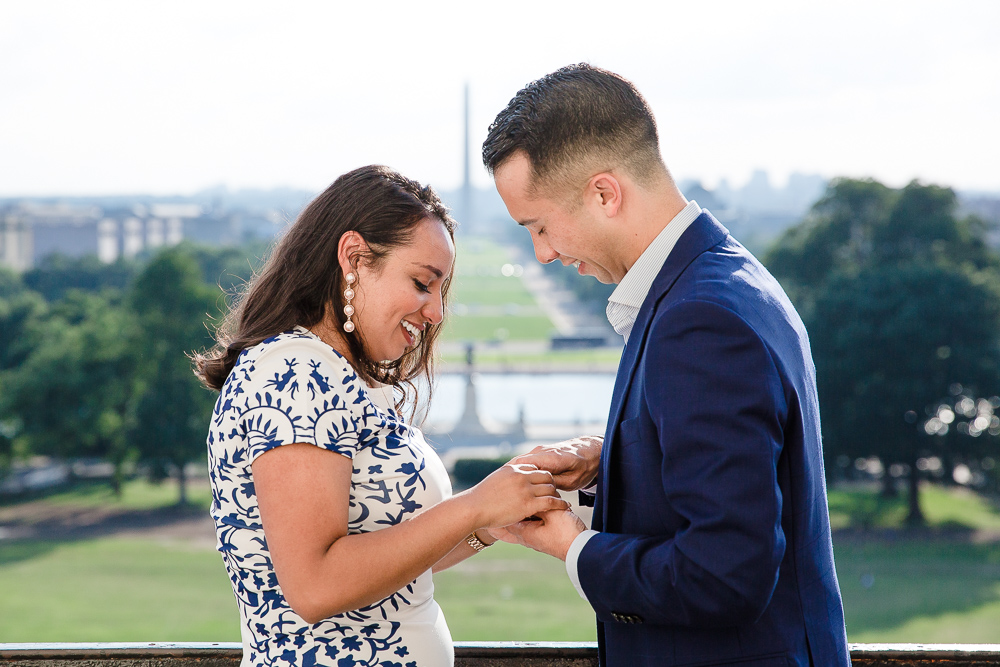 Putting the engagement ring on her finger | Washington, DC Proposal Photographer