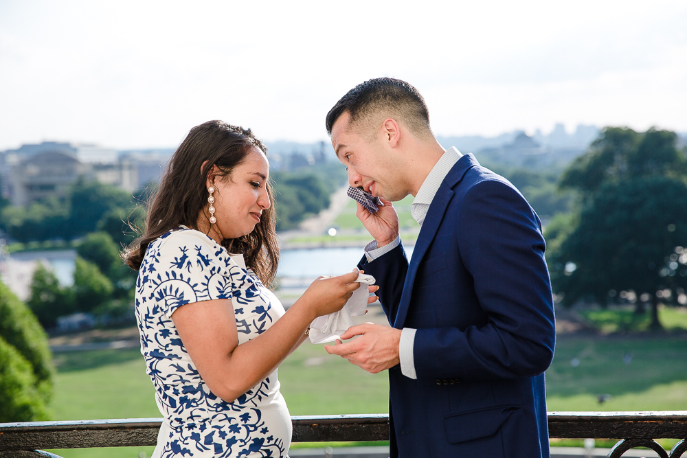 Candid and emotional engagement photos after the surprise proposal at the U.S. Capitol