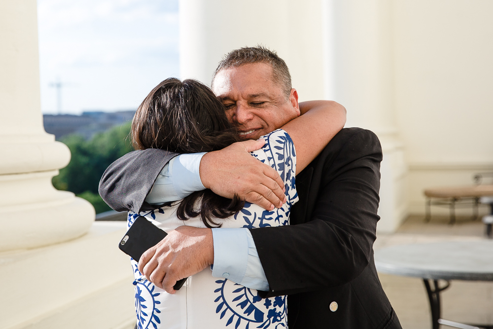 Bride-to-be hugging her dad after getting engaged on the Speaker's Balcony