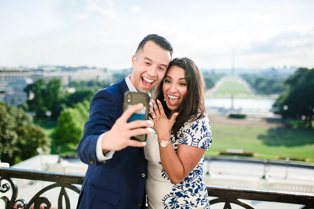 Fun engagement photo on the Speaker's Balcony of the U.S. Capitol | Fun DC engagement photographer