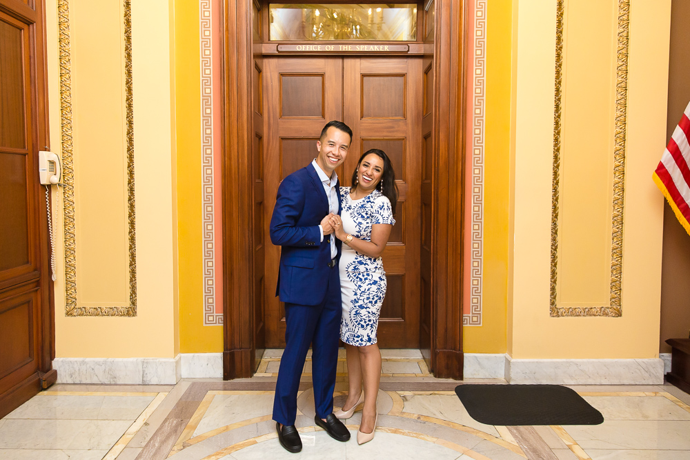 Happy engaged couple by the Office of the Speaker in the Capitol Building, Washington, DC