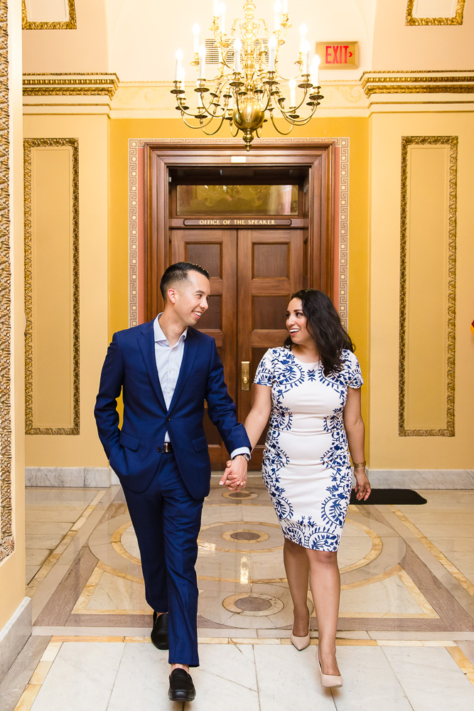 Candid engagement pictures in the hallways of the U.S. Capitol Building in Washington, DC