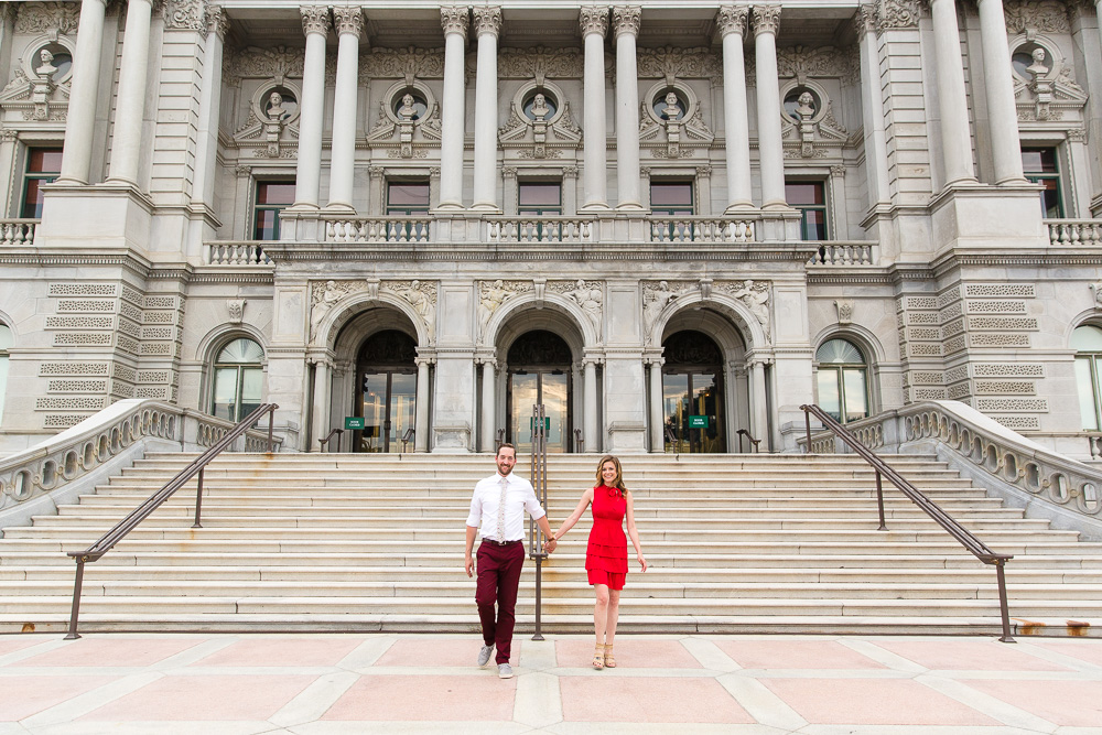 Engaged couple in front of the staircase at the Library of Congress