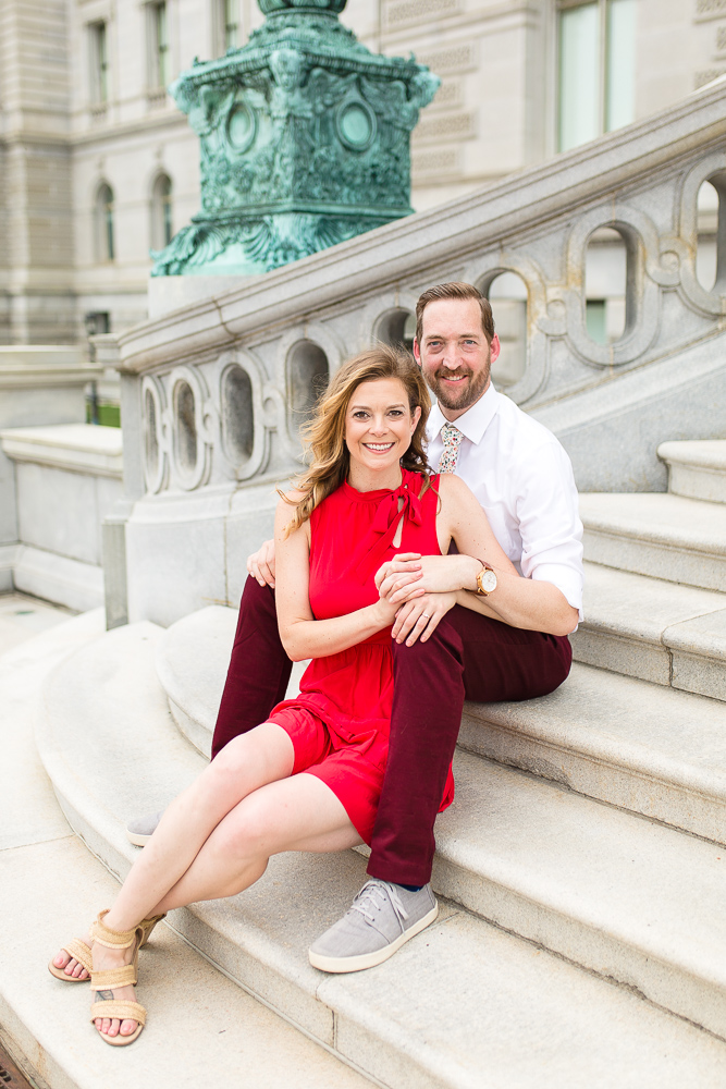 Engaged couple sitting on the steps at the Library of Congress | Best Washington, DC engagement photo locations