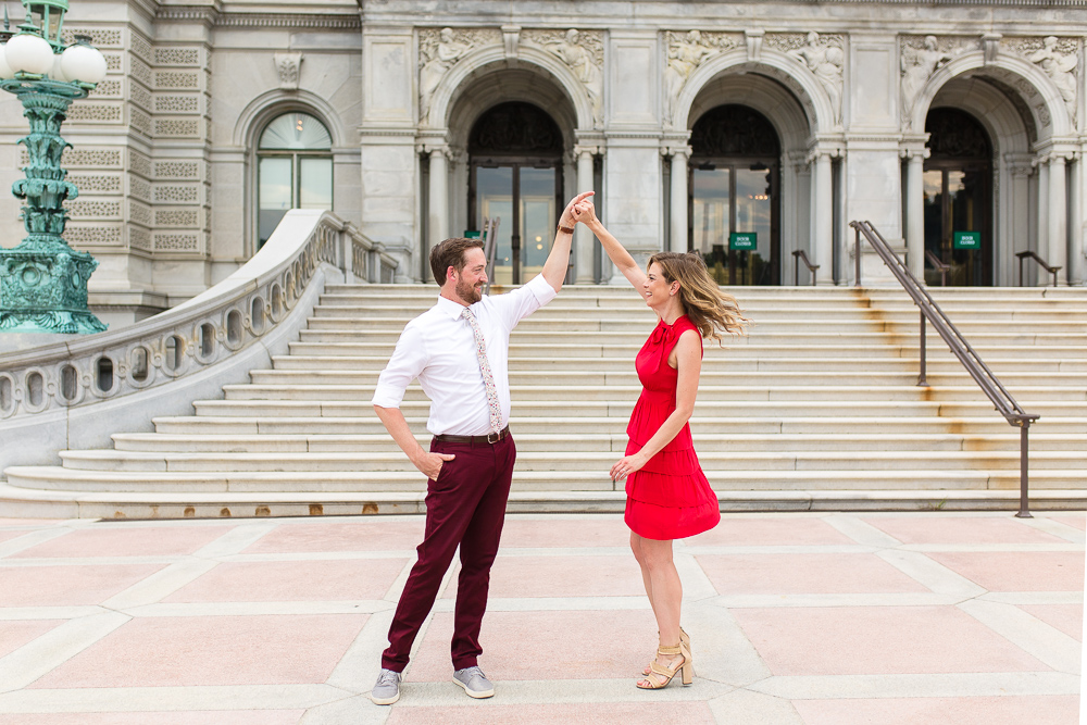 Dancing in front of the staircase at the Library of Congress | DC engagement photographer