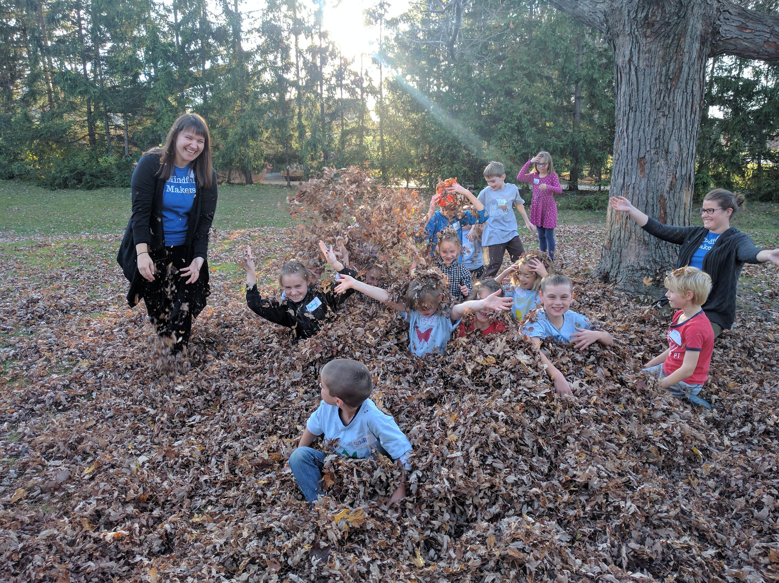 Enjoying the leaves in the backyard at our Nov. PA Day Camp.