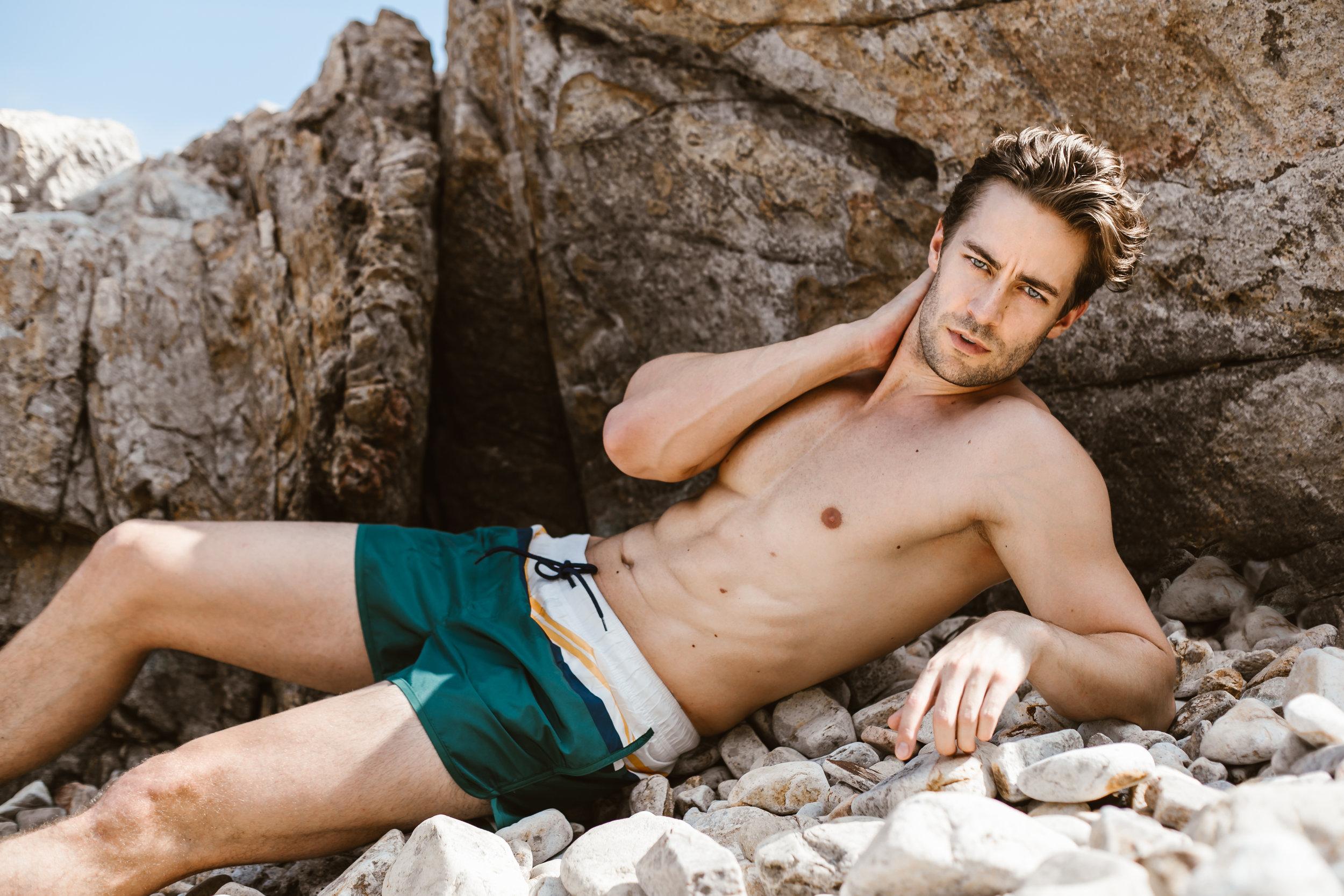 Jeremias wears swim shorts from H&M