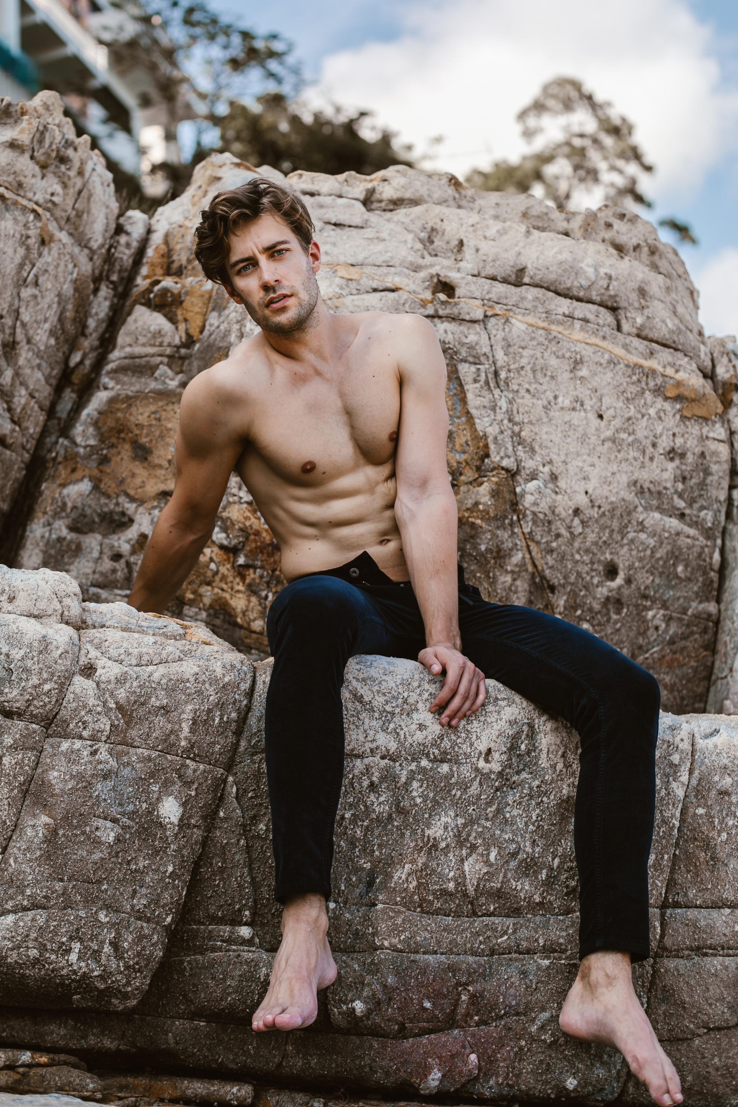 Jeremias wears corduroy jeans from Zara