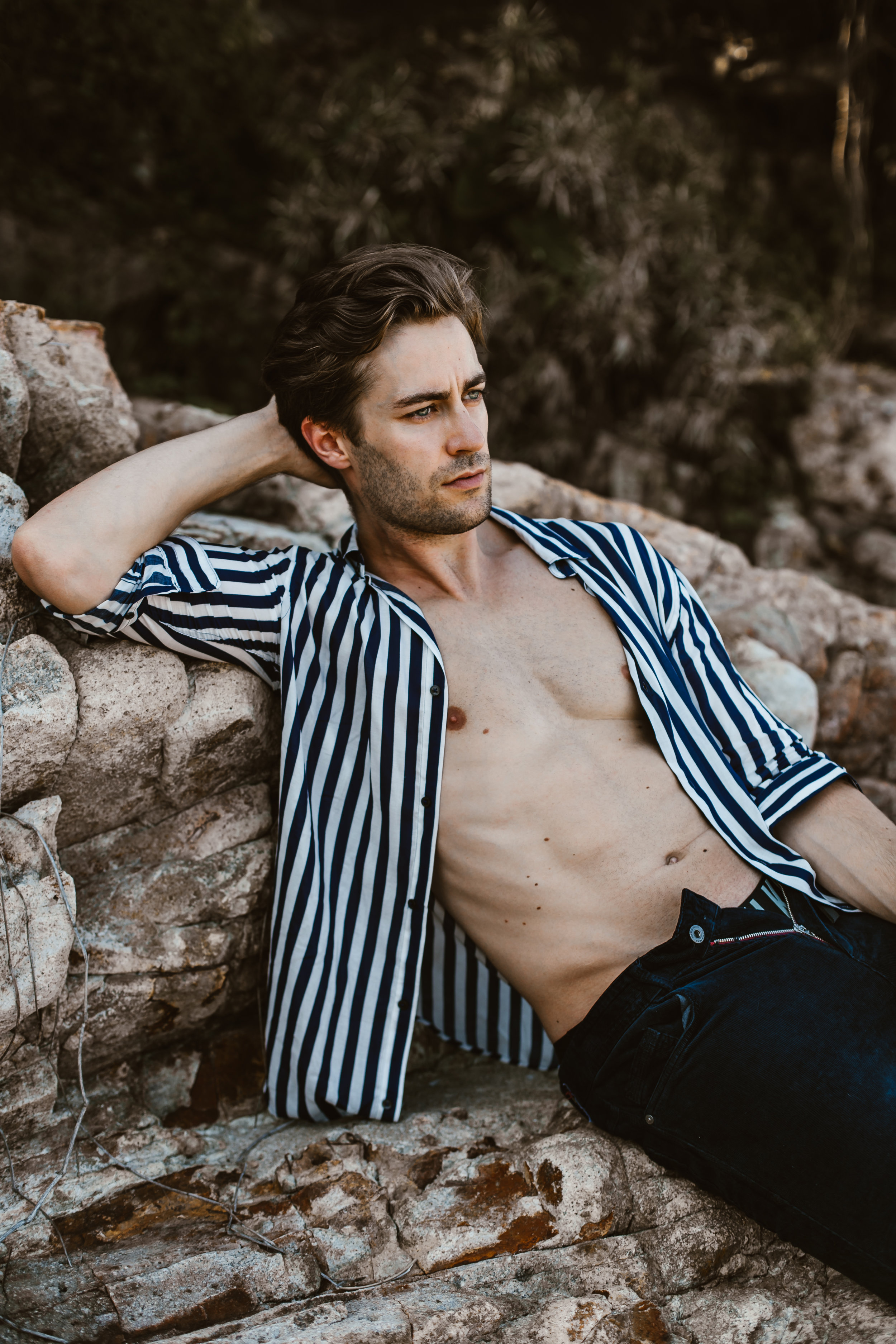 Jeremias wears striped shirt and corduroy jeans from Zara, and underwear from Calvin Klein