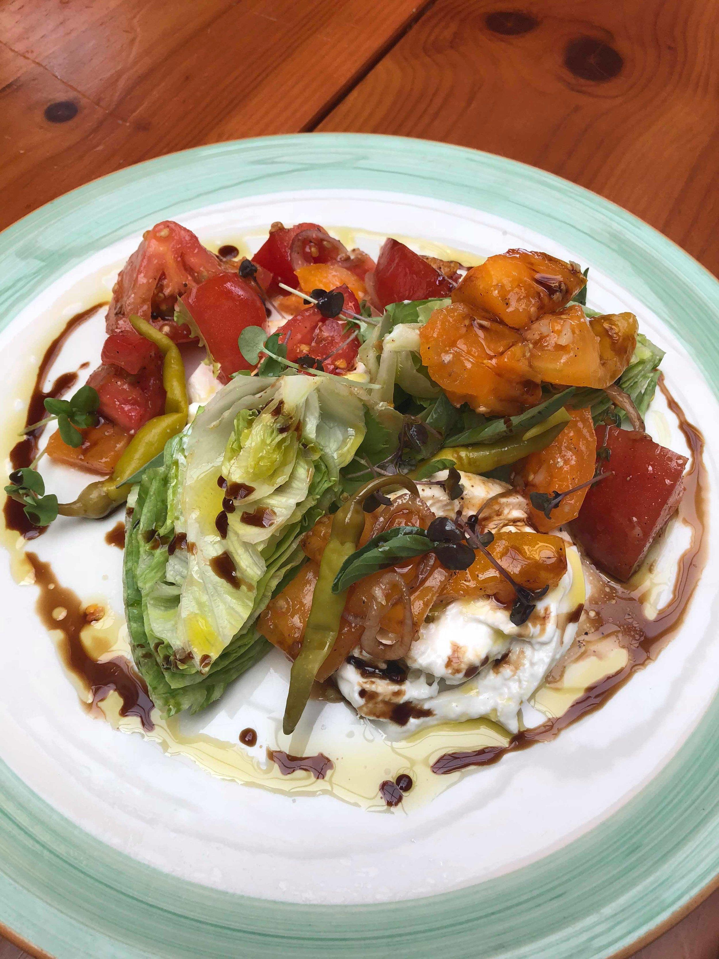 Burrata: heirloom tomato, sweet onion, basil, aged balsamic, olive oil