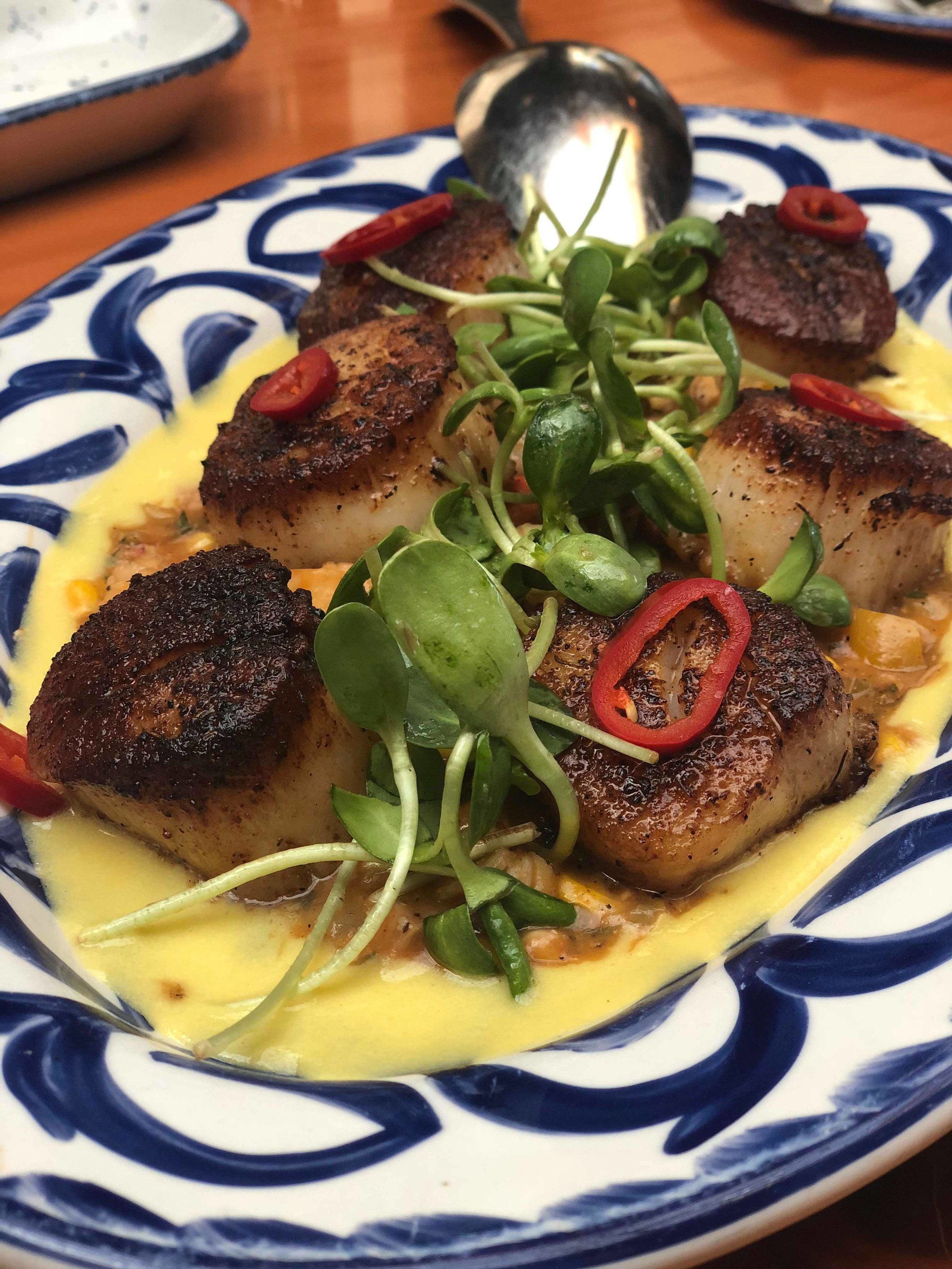 Creole Spiced Scallops: crayfish maque chouz, corn pudding, pickled chili, smoked shallots