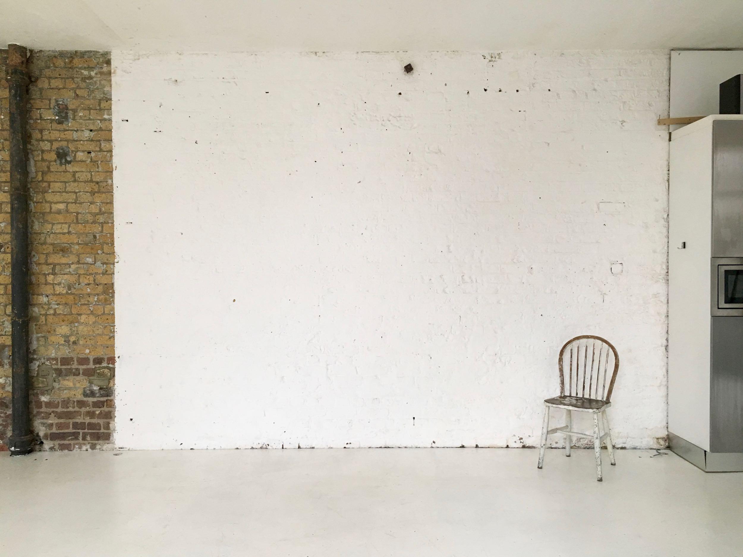studio one white painted brick wall
