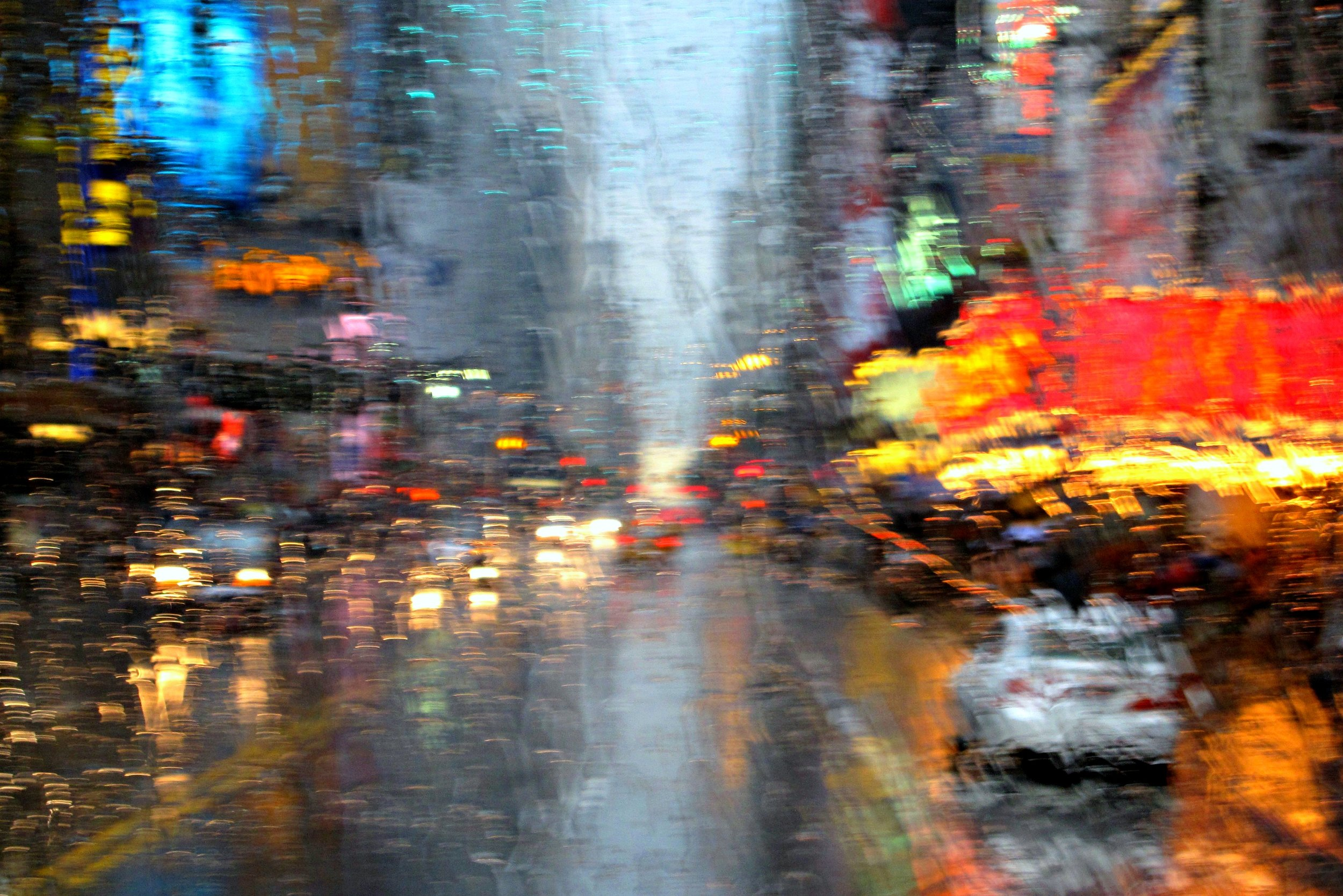 NYC in the rain from the front of a bus