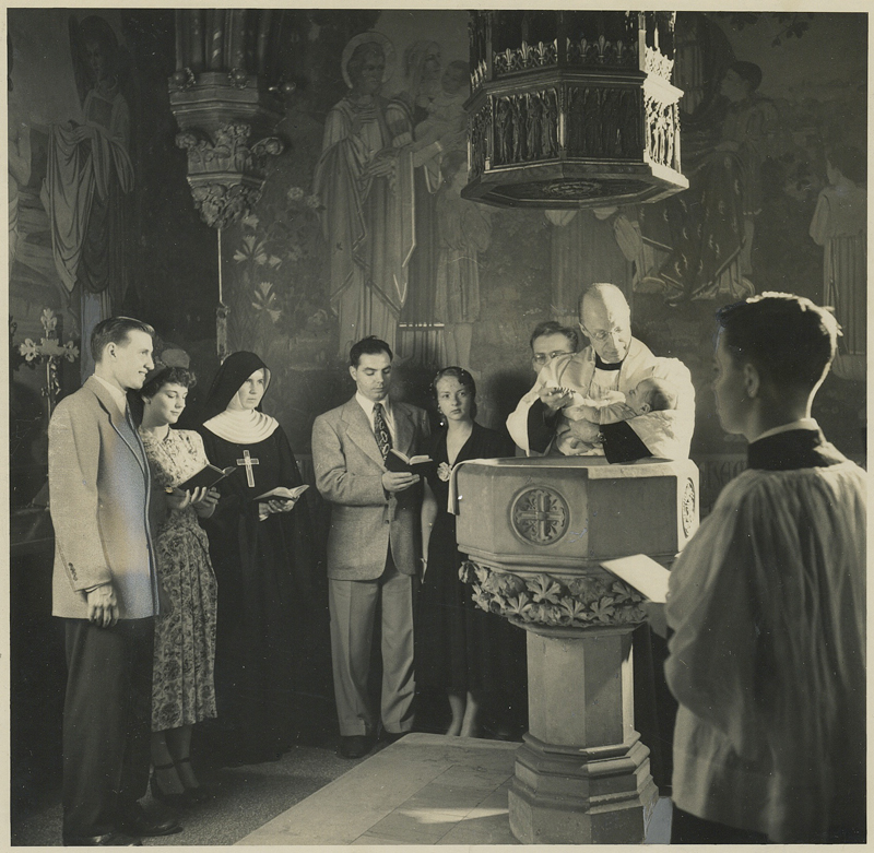 Baptism at Saint Mary's in the early 1950s, with a Sister from the Sisterhood of the Holy Nativity participating.