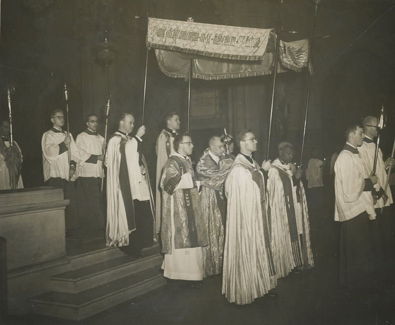 A Corpus Christ processional exiting the choir in the 1950s