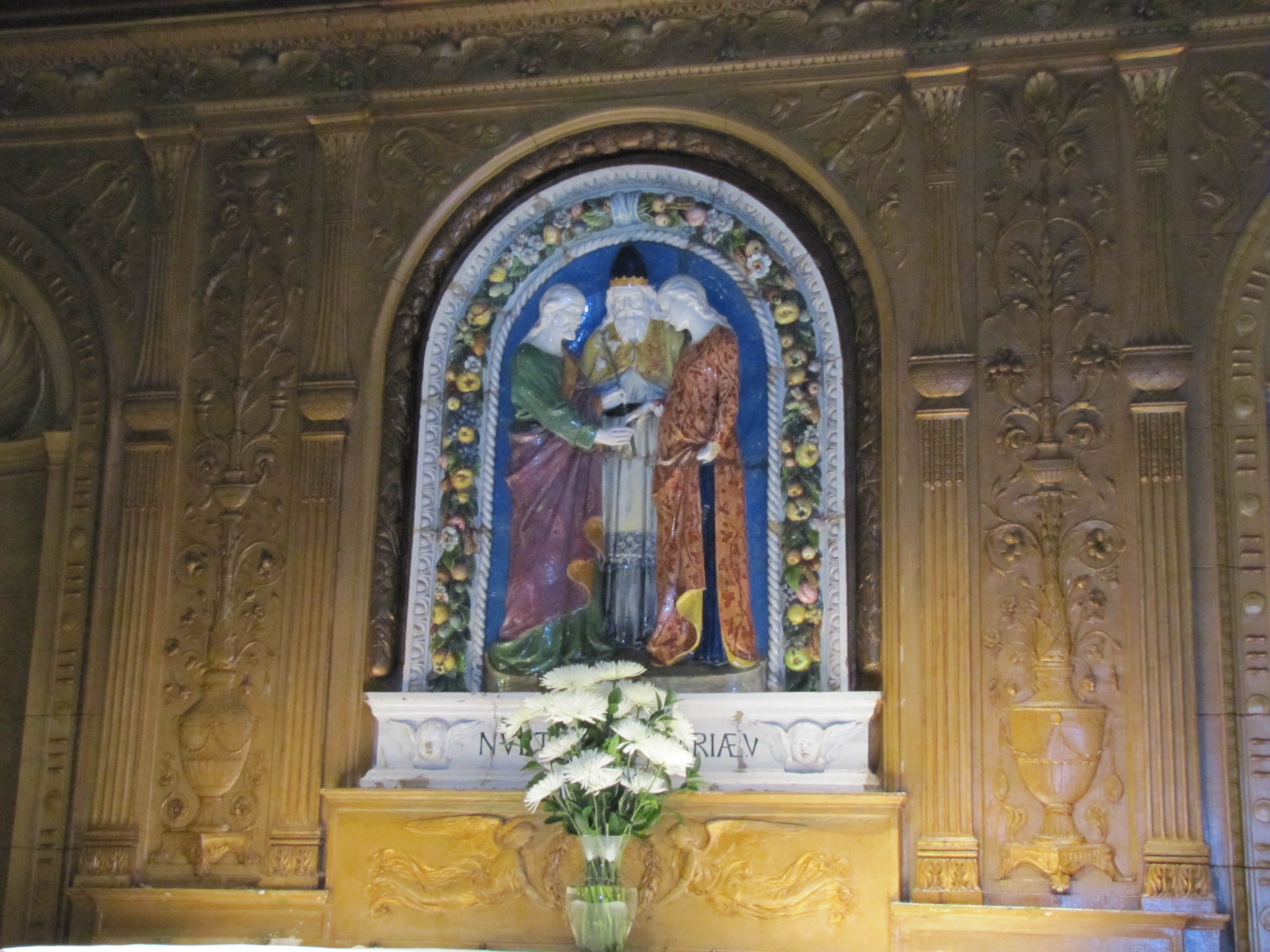 The Marriage of The Blessed Virgin Mary to Joseph - an Italian Terra Cotta in Saint Joseph's Chapel, where smaller weddings are often held at Saint Mary's.