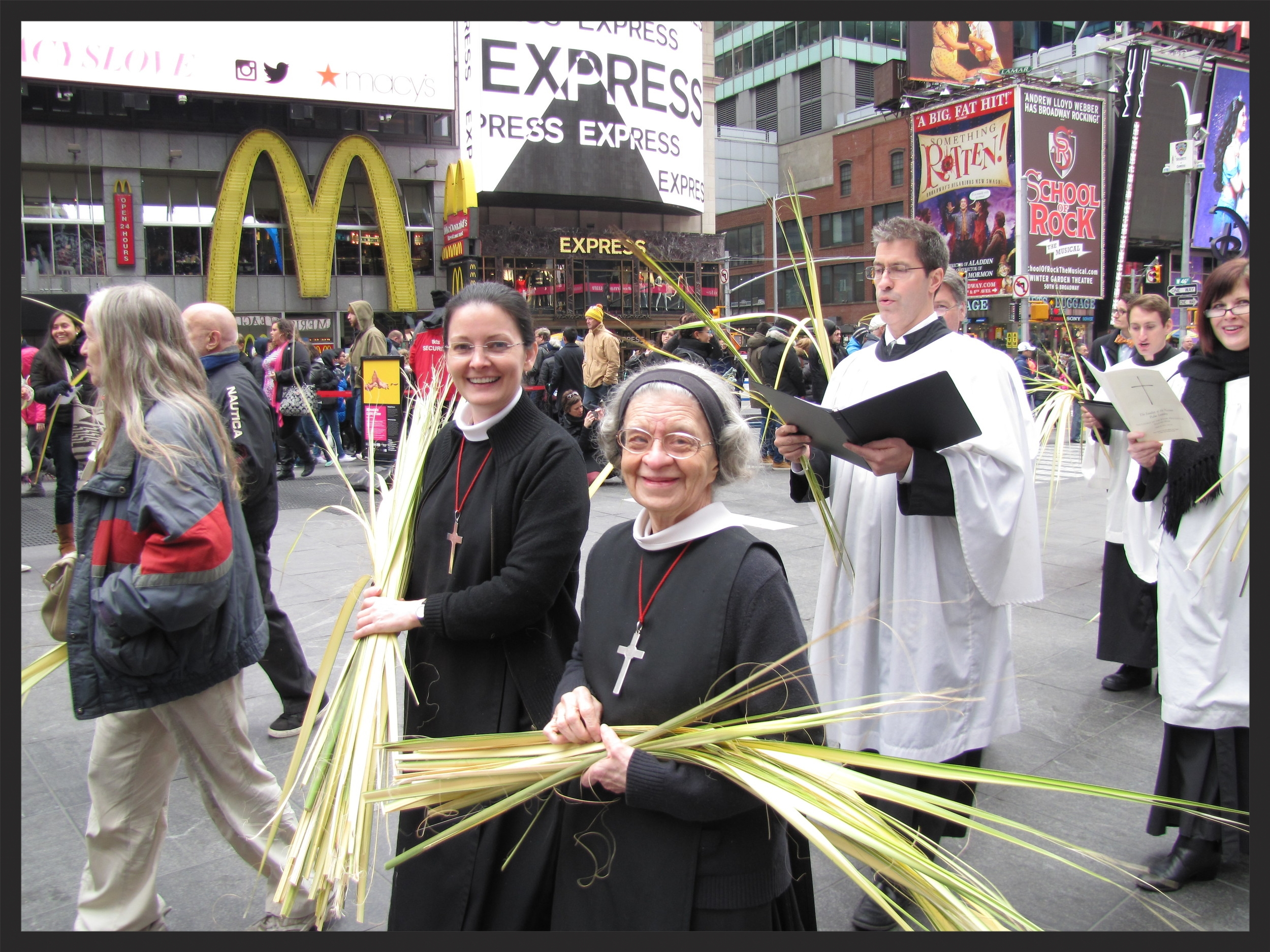Sister Monica Clare, CSJB (L) and Sister Laura Katharine, CSJB (R) in the Palm Sunday processional through Times Square