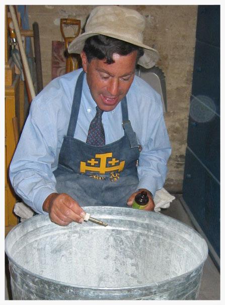 Ken Isler mixing incense at Saint Mary's
