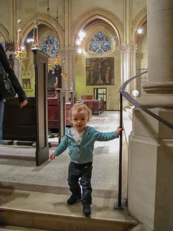 Jake Slusky-Sterbin continues to practice his walking while exploring the Church last Sunday.