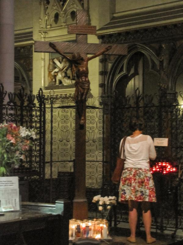 A visitor prays at the Calvary Shrine