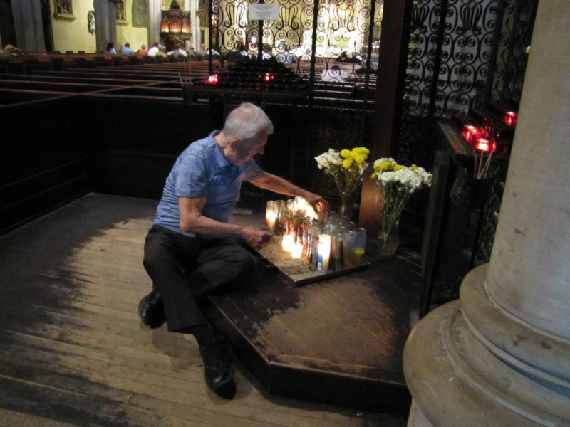 Parishioner Dick Leitsch tending to the candles at the Calvary Shrine
