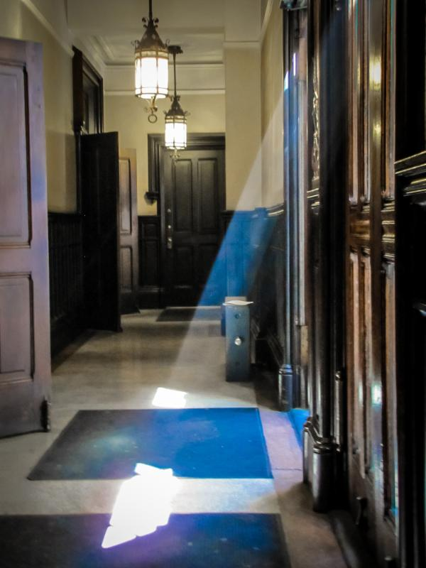 Sunlight filtering through the 46th Street doors of Saint Mary's