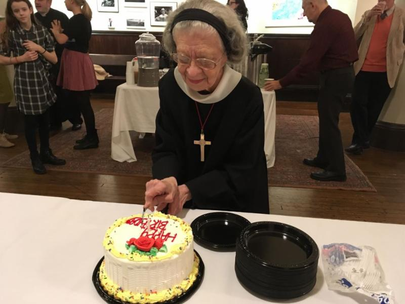Sister Laura Katharine cutting her birthday cake after Solemn Mass