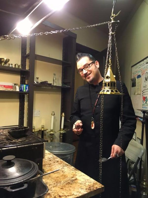 Thurifer Rick Miranda cleaning up   the Smoke Room after Solemn Mass