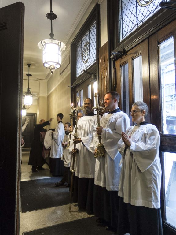 Servers in the narthex before the dismissal