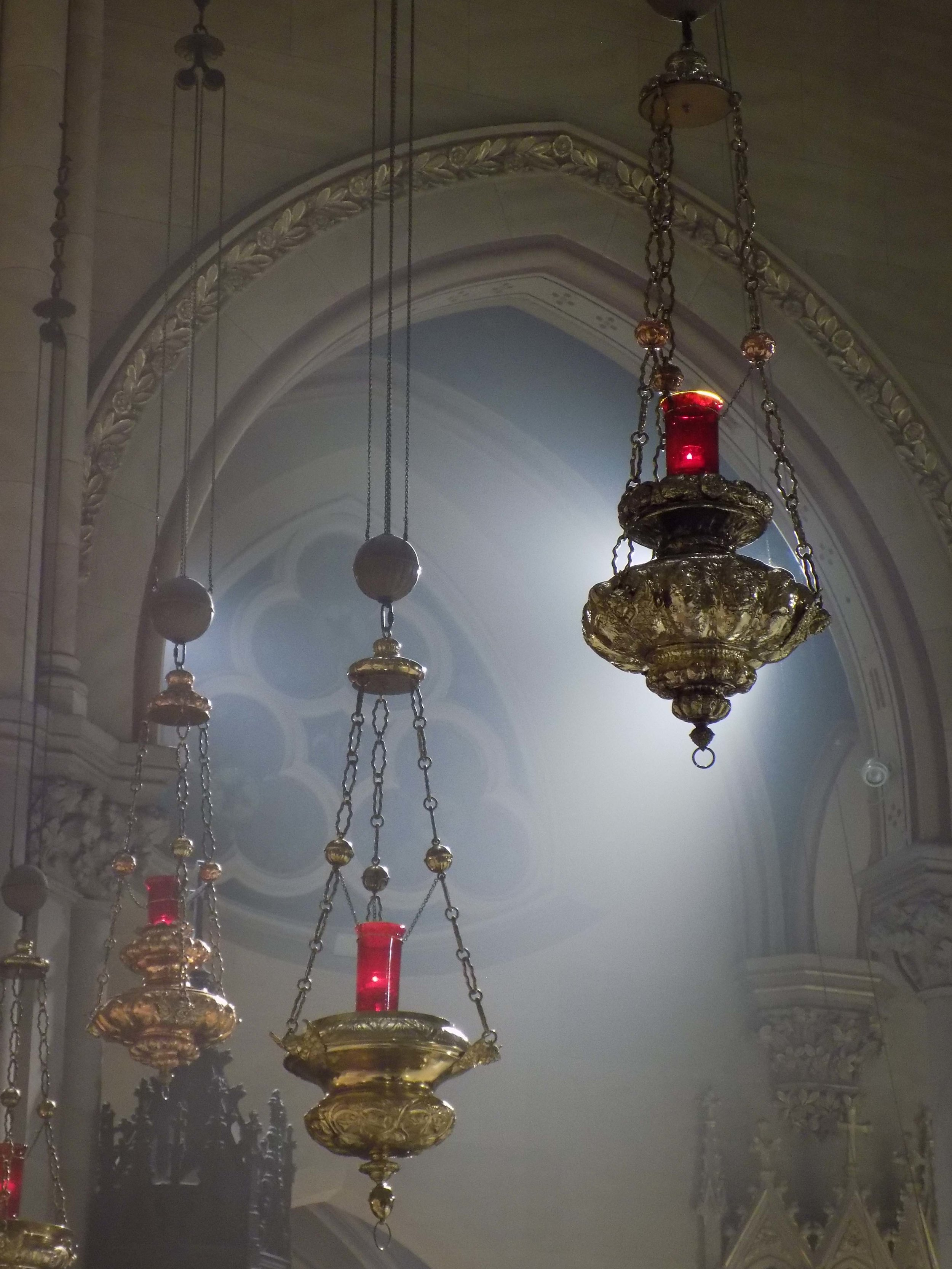 Light shines through incense clouds at Sunday Evensong.